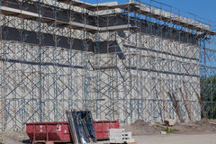 Block Wall with Scaffolding Royalty Free Stock Photos