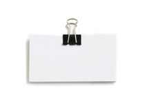 Block of white cards attached with paperclip. Isolated over white Royalty Free Stock Image