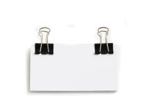 Block of white cards attached with paperclip. S, isolated over white Royalty Free Stock Photos