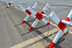 Block with wire barrier on the road Stock Image