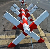 Block with wire barrier on the road Stock Photo