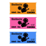 Blockbuster cinema tickets. Set of three cinema tickets with a movie projector on them and the text blockbuster admit one written with black letters Stock Images