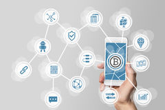 Blockchain and bitcoin concept visualized by mobile phone and grey background Stock Photography
