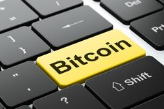 Blockchain concept: Bitcoin on computer keyboard background. Blockchain concept: computer keyboard with word Bitcoin, selected focus on enter button background Royalty Free Stock Photography