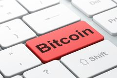 Blockchain concept: Bitcoin on computer keyboard background. Blockchain concept: computer keyboard with word Bitcoin, selected focus on enter button background Royalty Free Stock Image