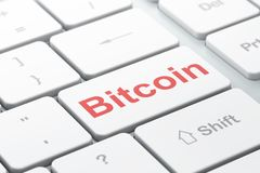 Blockchain concept: Bitcoin on computer keyboard background. Blockchain concept: computer keyboard with word Bitcoin, selected focus on enter button background Stock Photography