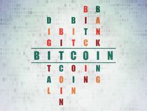 Blockchain concept: Bitcoin in Crossword Puzzle. Blockchain concept: Painted green word Bitcoin in solving Crossword Puzzle on Digital Data Paper background Royalty Free Stock Image