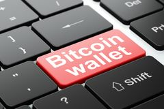 Blockchain concept: Bitcoin Wallet on computer keyboard background. Blockchain concept: computer keyboard with word Bitcoin Wallet, selected focus on enter Royalty Free Stock Photography
