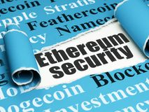 Blockchain concept: black text Ethereum Security under the piece of  torn paper. Blockchain concept: black text Ethereum Security under the curled piece of Blue Stock Images