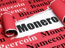 Blockchain concept: black text Monero under the piece of  torn paper. Blockchain concept: black text Monero under the curled piece of Red torn paper with  Tag Stock Image