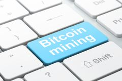 Blockchain concept: Bitcoin Mining on computer keyboard background. Blockchain concept: computer keyboard with word Bitcoin Mining, selected focus on enter Stock Images
