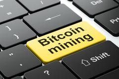 Blockchain concept: Bitcoin Mining on computer keyboard background. Blockchain concept: computer keyboard with word Bitcoin Mining, selected focus on enter Royalty Free Stock Images