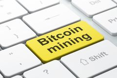 Blockchain concept: Bitcoin Mining on computer keyboard background. Blockchain concept: computer keyboard with word Bitcoin Mining, selected focus on enter Royalty Free Stock Image