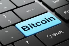 Blockchain concept: Bitcoin on computer keyboard background. Blockchain concept: computer keyboard with word Bitcoin, selected focus on enter button background Stock Image