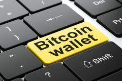 Blockchain concept: Bitcoin Wallet on computer keyboard background. Blockchain concept: computer keyboard with word Bitcoin Wallet, selected focus on enter Royalty Free Stock Image