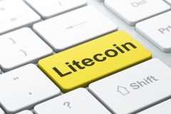 Blockchain concept: Litecoin on computer keyboard background. Blockchain concept: computer keyboard with word Litecoin, selected focus on enter button background Royalty Free Stock Image