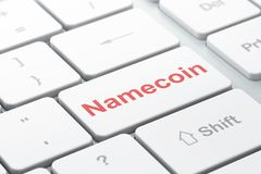 Blockchain concept: Namecoin on computer keyboard background. Blockchain concept: computer keyboard with word Namecoin, selected focus on enter button background Stock Images