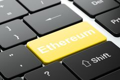 Blockchain concept: Ethereum on computer keyboard background. Blockchain concept: computer keyboard with word Ethereum, selected focus on enter button background Royalty Free Stock Photos