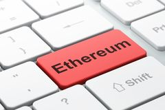 Blockchain concept: Ethereum on computer keyboard background. Blockchain concept: computer keyboard with word Ethereum, selected focus on enter button background Stock Photo