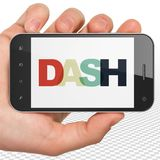 Blockchain concept: Hand Holding Smartphone with Dash on  display. Blockchain concept: Hand Holding Smartphone with Painted multicolor text Dash on display, 3D Royalty Free Stock Photos