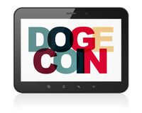 Blockchain concept: Tablet Computer with Dogecoin on  display. Blockchain concept: Tablet Computer with Painted multicolor text Dogecoin on display, 3D rendering Stock Photography