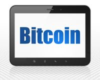 Blockchain concept: Tablet Pc Computer with Bitcoin on display. Blockchain concept: Tablet Pc Computer with blue text Bitcoin on display, 3D rendering Royalty Free Stock Photos