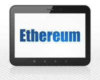 Blockchain concept: Tablet Pc Computer with Ethereum on display. Blockchain concept: Tablet Pc Computer with blue text Ethereum on display, 3D rendering Royalty Free Stock Photos