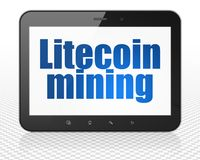 Blockchain concept: Tablet Pc Computer with Litecoin Mining on display. Blockchain concept: Tablet Pc Computer with blue text Litecoin Mining on display, 3D Stock Images