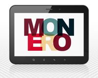 Blockchain concept: Tablet Pc Computer with Monero on  display. Blockchain concept: Tablet Pc Computer with Painted multicolor text Monero on display, 3D Royalty Free Stock Image
