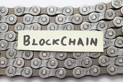 Blockchain concept. Text on bicycle chain royalty free stock photo
