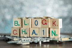 Blockchain cryptocurrency concept. Wood blocks say block chain w. Ith binary code on motherboard with crypto currency coins and copy space royalty free stock image