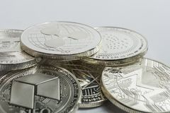 Blockchain cryptocurrency physical coins surrounded with variety of other crypto altcoins. royalty free stock images
