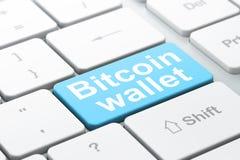 Blockchain-Konzept: Bitcoin-Geldbörse auf Computertastaturhintergrund Stockbild
