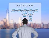 Senior technologist looking at blockchain illustration Royalty Free Stock Image