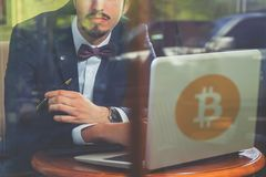 Blockchain technology. Bad news with bitcoin cryptocurrency. Succesful man hands up. Using laptop. Concept of success Stock Image