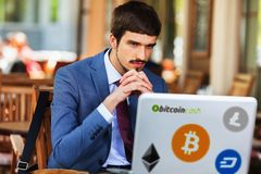 Blockchain technology. Bad news with bitcoin cryptocurrency. Succesful man hands up. Using laptop. Concept of success Stock Photos