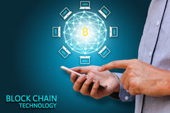 Blockchain technology concept, Businessman holding smartphone an. D virtual system diagram bitcoin and data protection Royalty Free Stock Photo