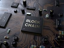 Blockchain technology concept on circuit board royalty free stock photo