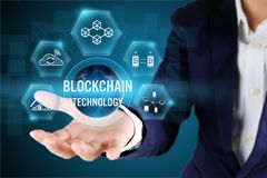 Blockchain technology concept,Elements of this image furnished by NASA. Businessman holding blockchain icon on virtual screen,Blockchain technology concept stock photos