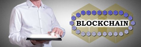 Blockchain technology concept with man using a tablet royalty free stock photography