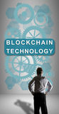 Blockchain technology concept watched by a businessman Stock Images