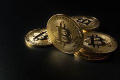 Crypto currency gold Bitcoin. Blockchain technology, Crypto currency gold Bitcoin on dark background royalty free stock images