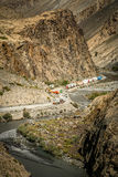 Blocked mountain road. Transport trucks waiting for the clearing of the  Karakorum Highway from a landslide that caused artificial lake Northern Pakistan Royalty Free Stock Image