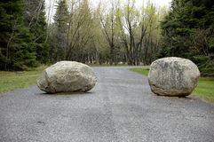Blocked Road. Two huge boulders block a country road Stock Photography