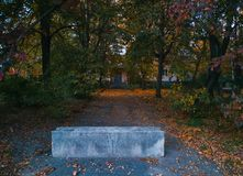 blocked road to abandoned building at autumn evening stock photo