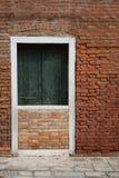 Blockerad dörr vid väggen Royaltyfria Bilder
