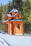 Blockhaus im Winter Stockbilder