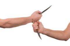Blockieren von Armen mit einem Messer Stockfoto