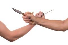 Blockieren von Armen mit einem Messer Stockfotografie