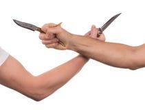 Blockieren von Armen mit einem Messer Stockbild